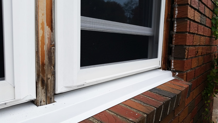 New window installation with PVC trim covering