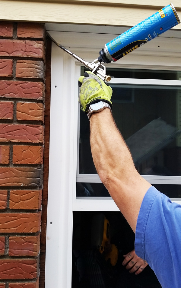 Apply Caulking To Seal New Windows